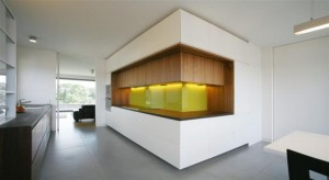 linear, light kitchen, lacquered, wood & glass with separated functional elements. Design: Kaell Architect